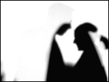 Video Clip - Human figures depicted in black in front of a white background; walking in the office