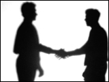 Video Clip - Human figures depicted in black in front of a white background; talking followed by hand shake