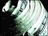 Video Clip - Roll of hundred dollar bills spinning