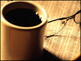 Video Clip - Pair of glasses and coffee resting on Wallstreet paper