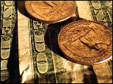 Video Clip - Several quarters laid out on a few dollar bills