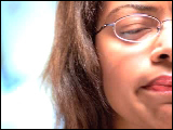 Video Clip - Woman with glasses thinking while showing facial expressions