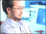 Video Clip - Japanese man staring blankly at a computer monitor