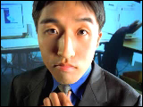 Video Clip - Asian man tightening his tie