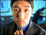 Video Clip - Asian man tightening his tie