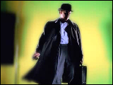 Video Clip - Man with a hat and a brief case answering his cell phone in slow motion