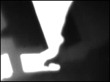 Video Clip - Human figures depicted in black in front of a white background; set of hands typing away