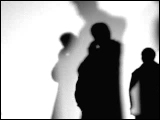 Video Clip - Human figures depicted in black in front of a white background; people talking on the phone