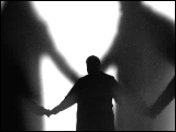 Video Clip - Human figures depicted in black in front of a white background; people holding hands
