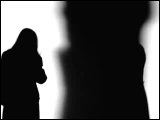 Video Clip - Human figures depicted in black in front of a white background; talking on the phone outside