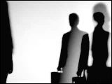 Video Clip - Human figures depicted in black in front of a white background; waiting with brief cases