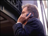 Video Clip - A man in the business attire using a cell phone