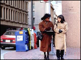 Video Clip - Two women in business attire crossing a street