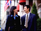Video Clip - A man and woman, both of Asian decent, in business attires walking outside an embassy building