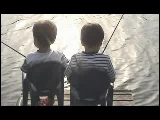 Video Clip - Two little boys sitting beside each other and fishing