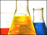 Video Clip - Red, yellow and blue liquids are shown in a beaker and two flasks