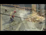 Video Clip - A highrise being built with crane, tools and other heavy machinery