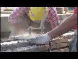 Video Clip - A resisential house being built with tools and other heavy machinery