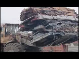 Video Clip - Scrap metal being recycled at a facility
